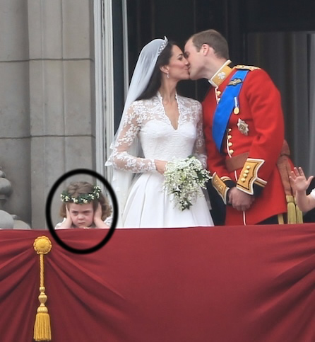 grumpy flower girl bridesmaid royal wedding hands over ears royal kiss on balcony will kate dress daughter circled demon
