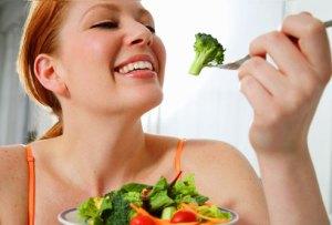 woman eating-vegetables vitamins nutrient